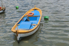 Small wooden motor boat moored up Royalty Free Stock Image