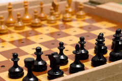 Small wooden old travel chess set.  Stock Photos