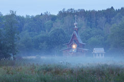Small wooden orthodox church in the twilight Royalty Free Stock Photography