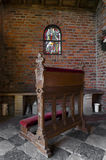 Church pew. Small wooden pew in a chapel Royalty Free Stock Images