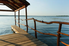 Small wooden pier on the lake. Small wooden pier on the lake Stock Images