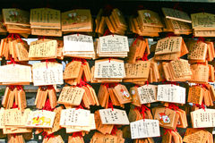 Small wooden plates with written wishes at Japanese temple Stock Image