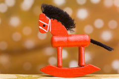 Small wooden rocking horse Stock Images