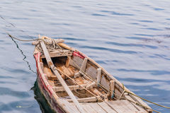 Small wooden rowboat with floating in calm Royalty Free Stock Photo