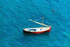 Small Wooden Sailboat at Sea Stock Image