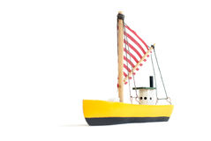 Small wooden sailing ship. Small yellow toy sailing boat on white background Royalty Free Stock Photos