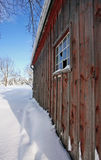 A small wooden shed. On sunny winter day Royalty Free Stock Photography