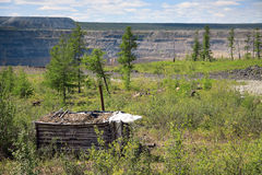 Small wooden shelter at the edge of open mine Stock Image