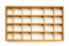 Small wooden shelves. On white wall Stock Photography