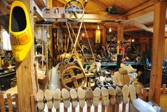 Small wooden shoe workshop at Zaanse Schans, Netherlands. A small wooden shoe Workshop offers demonstration of wooden clog making at Zaanse Schans, Netherlands royalty free stock images