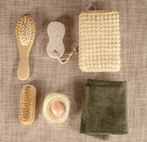 Small wooden spa set, sponge, pumice stone, a mirror, towel, brush, comb Stock Photo