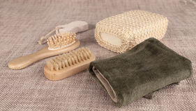 Small wooden spa set, sponge, pumice stone, a mirror, towel, brush, comb Royalty Free Stock Image