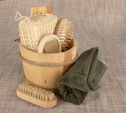 Small wooden spa set, sponge, pumice stone, a mirror, towel, brush, comb Royalty Free Stock Photos