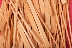 Small Wooden sticks mix on a red background stock photo