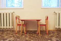 Small wooden table and two chairs Stock Photos