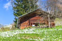 Small wooden traditional alpine cabin in the mountains of the Al Royalty Free Stock Photography