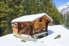 Small wooden traditional alpine cabin. Stock Images