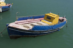 Small wooden traditional Greek  fishing boat Stock Photos