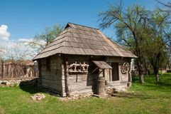 Small wooden traditional house in Romanian village Royalty Free Stock Photos