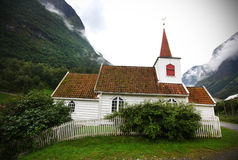 Small wooden village church in the valley, Norway Stock Image