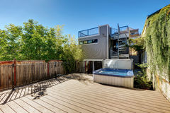 Small Wooden walkout deck with hot tub. House exterior. Wooden walkout deck with hot tub. House exterior in Tacoma. Northwest, USA Stock Photo