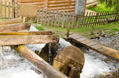 Small wooden waterwheel Royalty Free Stock Image