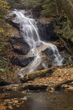 Small Woodland Waterfall. Waterfall over rocks in a woody forest Royalty Free Stock Image