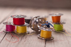 Small worker prepares the material for sewing. Tailoring concept Royalty Free Stock Photos