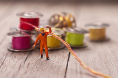 Small worker prepares the material for sewing. Tailoring concept Royalty Free Stock Photo