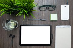 A small workplace with a tablet in a cafe. with clipping path for screen. top view royalty free stock photos