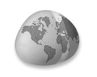 A Small World. A map of the world carved on stone on a pebble, could the 'little planet' concept Royalty Free Stock Photography