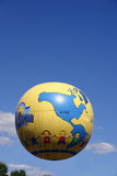 Small world. A helium filled balloon floating over Branson Missouri. This is used for promotional purposes Stock Images
