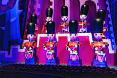 It is the small world, Disneyland Paris. It is the small world tin soldiers playing music on the stage at Disneyland Paris royalty free stock photography