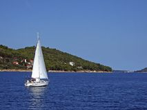 Small yacht. A small ship in Mediterranian, near Croatian coast, summer Royalty Free Stock Photography
