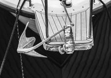 Small yacht with an anchor. And damaged front Royalty Free Stock Photo