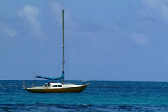 Small Yacht anchored near shore. Of the sea Royalty Free Stock Image