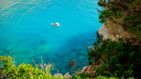 Small yacht anchored at Porto Katsiki beach on Lefkada island Stock Photo
