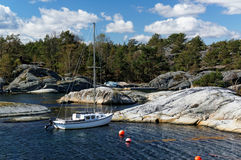 Small yacht on the coast in Norway Stock Images