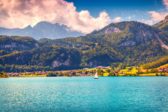 Small yacht on Lungerersee lake near Swiss village Lungern Royalty Free Stock Photos