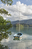 Small yacht moored on Lake Bled, Slovenia. Royalty Free Stock Image