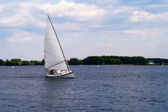 Small yacht on the move Stock Photography