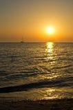 Small yacht at sunset Stock Photos