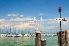 Small yachts in harbor in Desenzano, Garda lake, Italy Royalty Free Stock Photo