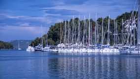Small yachts moored in the inlet at Vrboska stock photo