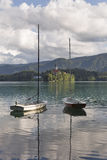 Small yachts moored on Lake Bled, Slovenia. Stock Images