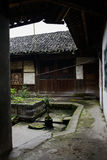 Small yard before ancient Chinese wooden house Royalty Free Stock Image