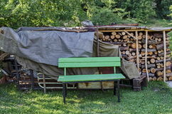Small yard with woodstack and place for rest. Zheleznitsa village, Bulgaria Stock Image