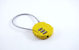 Small yellow baggage numeric lock Stock Photography