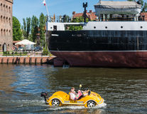 Small yellow boat on Motlawa River in Gdansk, Poland. Stock Photography