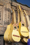 Small yellow colored guitars Royalty Free Stock Images